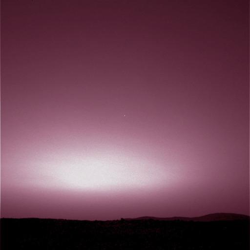 La Terre (petit point au centre de l'image) perdue dans le rougeoiement violacé du coucher de soleil martien et saisie par Spirit