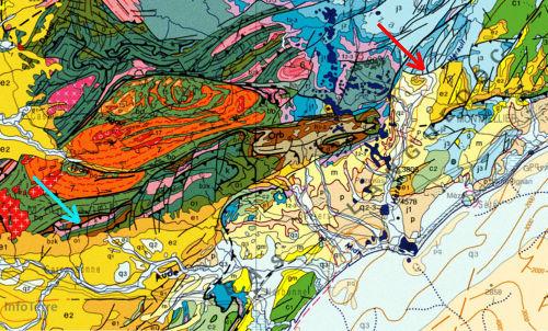 Extrait de la carte géologique de France au 1/1000000 montrant la localisation de la grotte de Limousis (flèche bleu) dans des calcaires dolomitiques dévoniens, et de Clamouse (flèche rouge) dans des calcaires dolomitiques jurassiques