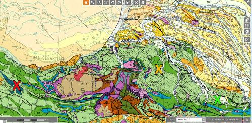 Agrandissement de la carte géologique de la France au 1/000000 localisant les affleurements du synclinal de Bilbao (croix rouge) et les affleurements de Saint-Palais et d'Oloron-Sainte-Marie (croix orange et verte)