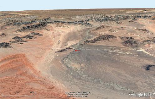 Cadre morphologique du canyon de Sesriem (flèche rouge au centre de l'image), Namibie