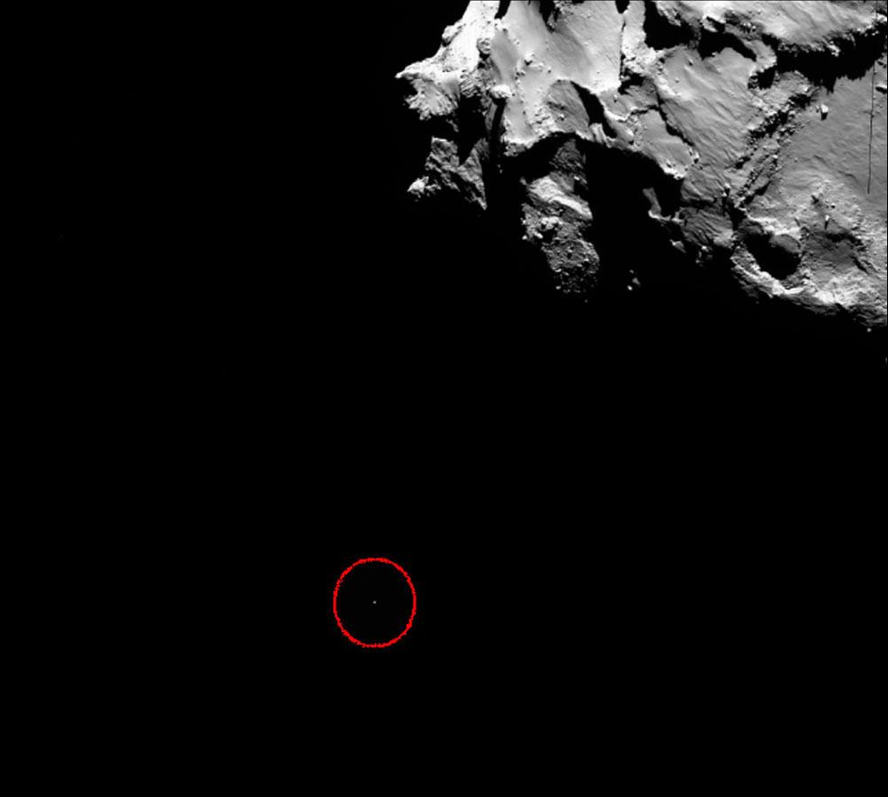 Philae (point blanc dans le cercle rouge) et la comète Chury, vus par Rosetta avec la caméra OSIRIS grand angle à 14h19min TU, le 12 novembre 2014