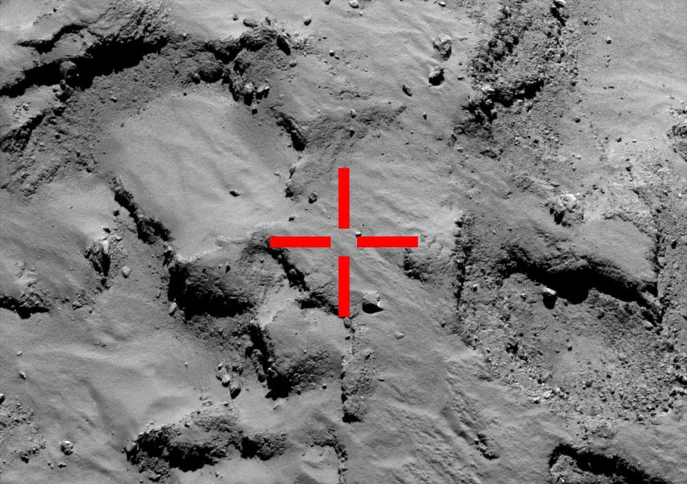 Position du point d'atterrissage prévu (croix rouge) reporté sur une image OSIRIS petit champ prise le 14 septembre 2014 (3,5 semaines avant la séparation Rosetta/Philae) depuis une distance de 30km de la surface