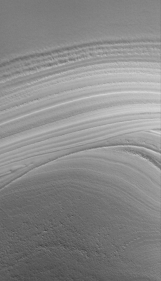 Exemple de 2 surfaces d'érosion («discordances») internes à la calotte résiduelle Nord de Mars
