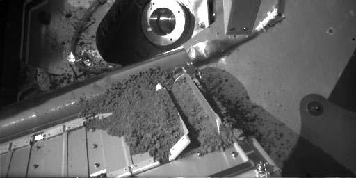 Remplissage d'un des huit mini-fours de Phoenix (Mars)