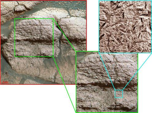 """Affleurement photographié par Opportunity montrant des strates horizontales perforées de """"trous"""" de forme géométrique"""